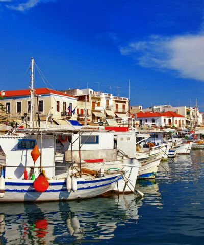 Egina è un'isola della Grecia situata nel golfo Saronico, distante un ora dal porto di Pireo. Deve il suo nome a quello della madre di Eaco, Egina appunto, che qui nacque e governò l'isola. Il capoluogo è la città omonima. L'economia dell'isola si basa sull'attività peschiera, l'agricoltura, produzione ceramica e sul turismo. In particolare, il pistacchio occupa un posto di rilevo nell'economia dell'isola, che è diventata una dei più grandi produttori, dopo l'introduzione avvenuta nel corso del Novecento. Annualmente si celebra un festival dedicato al pistacchio e i negozi dell'isola offrono una gamma estremamente diversificata di prodotti basati sul pistacchio. Sull'isola sorge il tempio di Afaia, degli inizi del V secolo a.C.