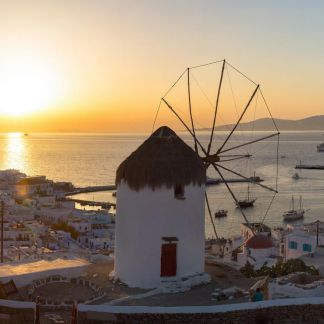 Mykonos is a Greek island, part of the Cyclades, lying between Tinos, Syros, Paros and Naxos. The town is also known as Chora. Mykonos's nickname is The island of the winds. Tourism is a major industry and Mykonos is well known for its vibrant nightlife.